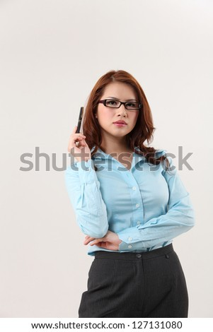 business woman posing and holding a pen confidence - stock photo