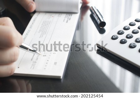 Business woman prepare writing a check - stock photo