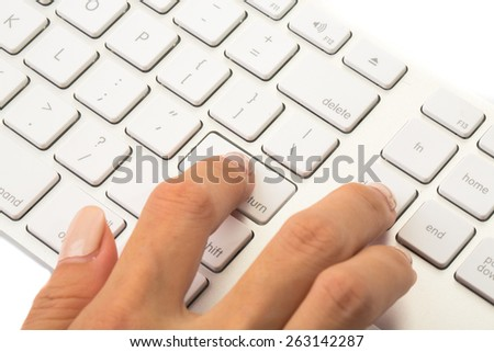 Business woman press enter on white keyboard to start or end commercial process.