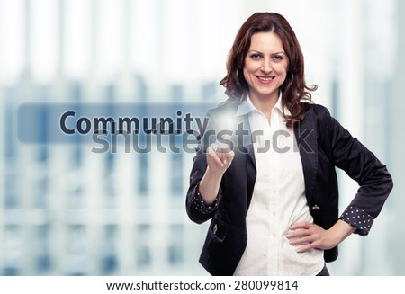 Business woman pressing Community button at her office. Toned photo - stock photo