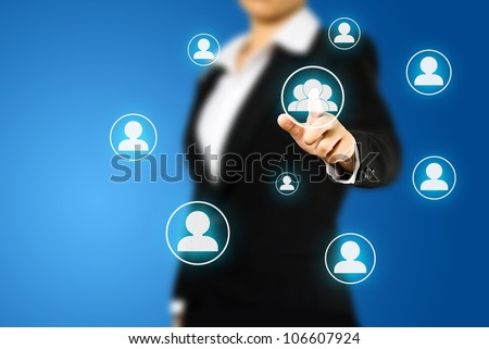 Business woman pressing Social network icon - stock photo