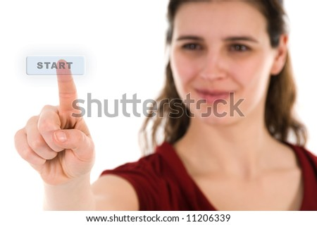 business woman pushing a key in mid air - stock photo