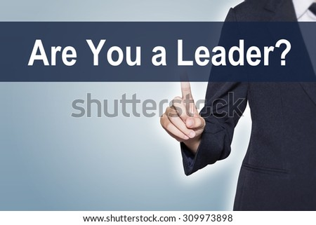 Business woman pushing hand Are you a leader on virtual screen for e-commerce background - stock photo