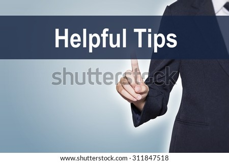Business woman pushing Helpful Tips on virtual screen for e-commerce background - stock photo