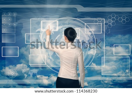 business woman pushing virtual button in web interface with her finger over blue sky - stock photo