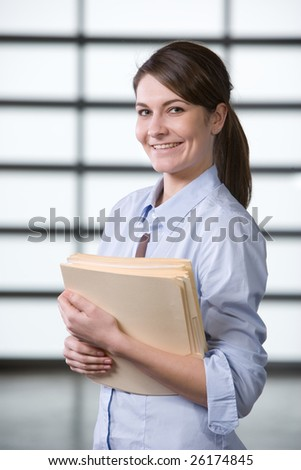 Business woman reading documents in modern office