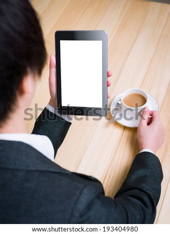 business woman reading information with tablet PC