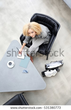 Business woman recorded expenses.