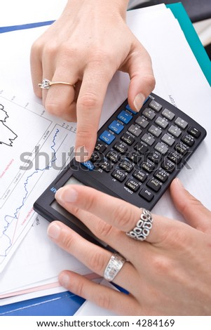 Business woman's hands and the calculator.