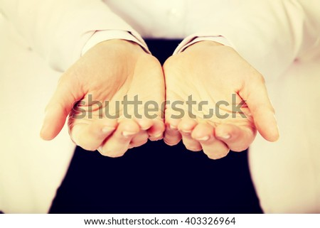 Business woman's hands holding something - stock photo
