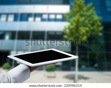 Business Woman's hands holding  tablet - stock photo