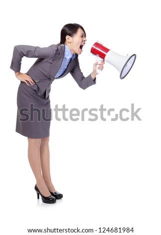 Business woman screaming with a megaphone to copy space in full length isolated on white background, model is a asian beauty