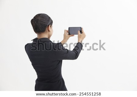 business woman self portrait with smart phone - stock photo