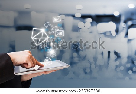 Business woman sending email in the shopping mall  - stock photo
