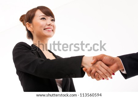 Business woman shaking with someone.