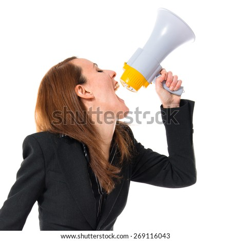 Business woman shouting by megaphone
