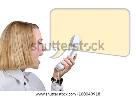 Business woman shouting into the telephone receiver, isolated on white background. Yellow speech bubble at the top of the photo for your text - stock photo