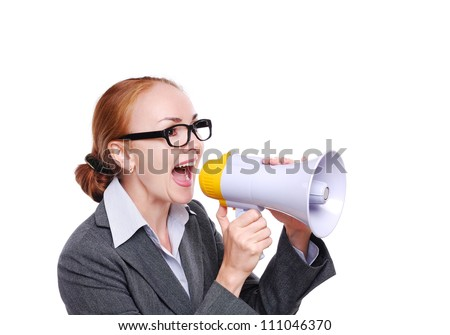 Business woman shouting  loud into a megaphone