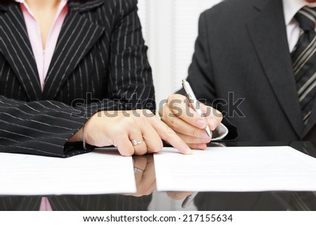 Business woman  show a businessman  to sign a agreement - stock photo