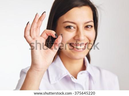 Business woman show ok symbol. - stock photo