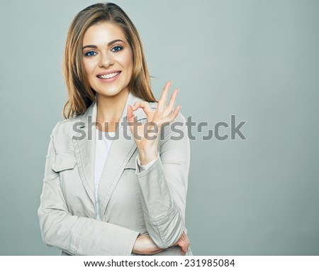 Business woman show ok symbol. Toothy smiling business woman portrait. - stock photo