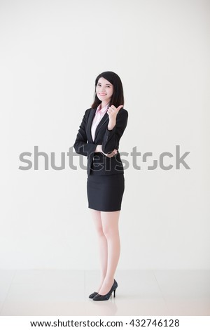 business woman show thumb up with white wall background, great for your design or text, asian - stock photo
