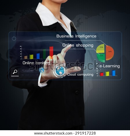 business woman showing a business graph on virtual screen - stock photo