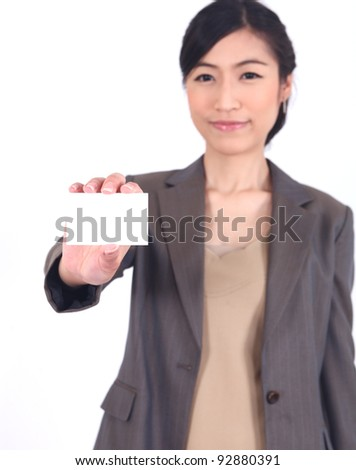 Business woman showing blank card. Focus on card. isolated over white - stock photo