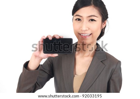 Business Woman Showing blank display of touch mobile cell phone (Focus on face snile) - stock photo