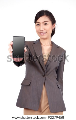 Business Woman Showing blank display of touch mobile cell phone (Focus on the hand and phone) - stock photo