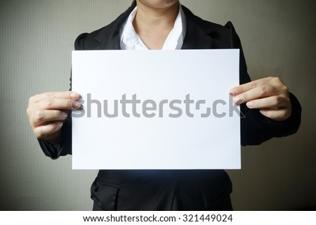 Business woman showing blank paper for you text , business idea concept - stock photo