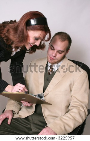business woman showing buisnessman her notes