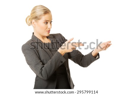 Business woman showing copy space. - stock photo