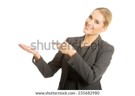 Business woman showing copy space on the left. - stock photo