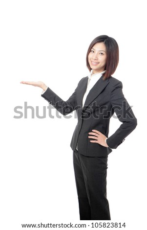 Business woman showing empty copy space by hand isolated on white background, model is a asian girl - stock photo