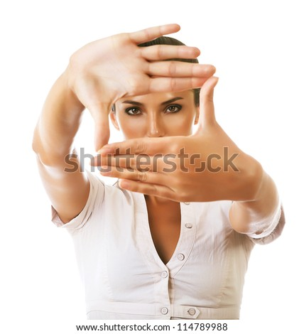 business woman showing framing hand gesture on white background - stock photo