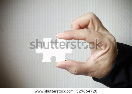 Business woman showing jigsaw puzzle. business idea concept