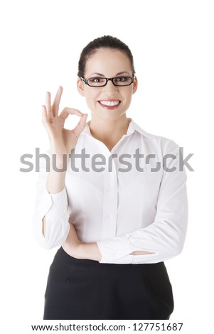 Business woman showing perfect hand sign smiling happy.