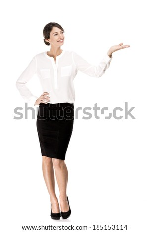 Business woman showing something with her hand, isolated over a white background - stock photo