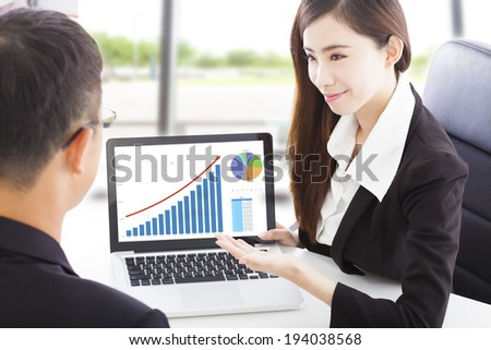 Business woman showing stock market financial situation - stock photo