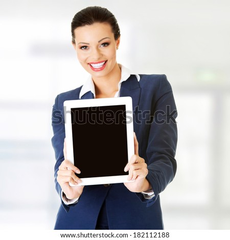 Business woman showing tablet PC with touch pad. - stock photo
