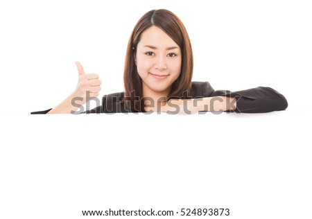 Business woman showing thumb up sign on white board