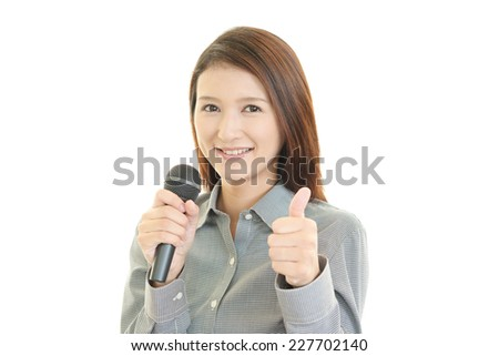 Business woman showing thumbs up sign