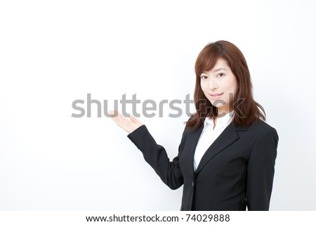 Business woman showing with hand on white space. - stock photo