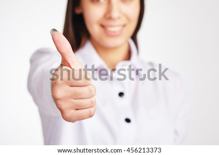 Business woman shows thumb up.