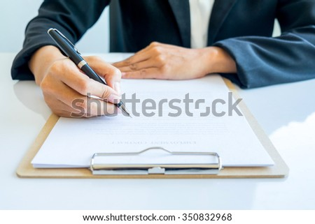Business woman signing a contract(selective focus) - stock photo
