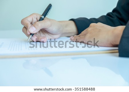 Business woman signing a contract (selective focus) - stock photo