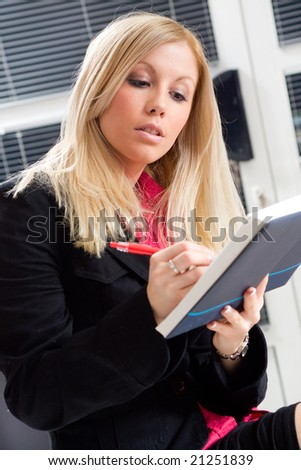 business woman sitting and making notes - stock photo