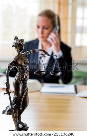 business woman sitting in an office. symbol photo for managers, independence or lawyer. - stock photo
