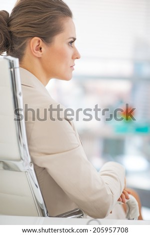Business woman sitting in office. rear view